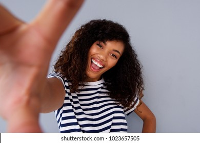 Portrait of attractive african woman smiling and taking selfie