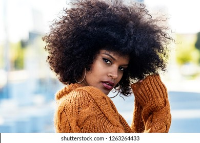 Portrait of attractive afro woman in the street. Hair style concept