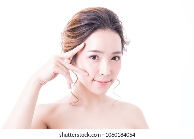 Portrait of attractive asian Korean woman skincare face facial treatment isolated on white background, asian beauty glow girl smile her fingers touching eyes. Surgery eyelid beauty technology concept