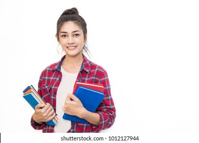 Portrait of attractive asian student ( woman ) standing holding reading a book with copy space over white background. Education exam preparing concept