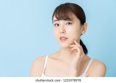 portrait of attractive asian woman beauty iamge on blue background