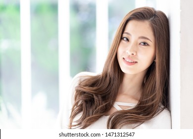 portrait of attractive asian woman hair care image