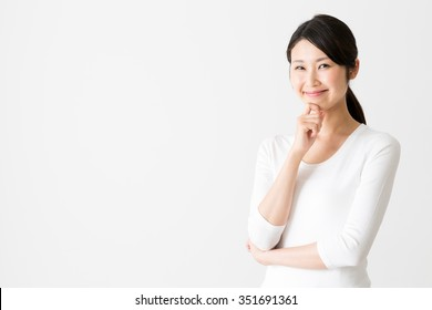 portrait of attractive asian woman isolated on white background