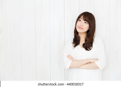 portrait of attractive asian woman isolated on wood background