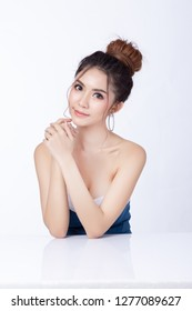 Portrait of attractive asian woman sitting smiling on white background. Healthy skin woman natural makeup beauty face concept. Using as your Product.