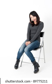 a portrait of attractive asian woman sitting
