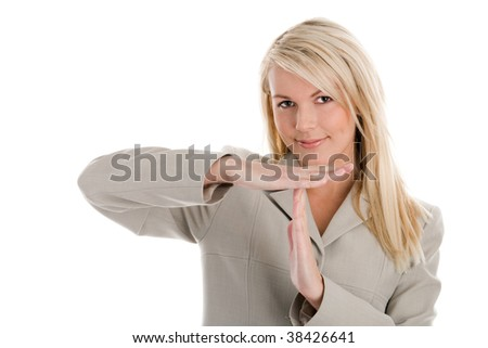 Portrait of attractive blond businesswoman indicating time sign isolated on white background. Time over.
