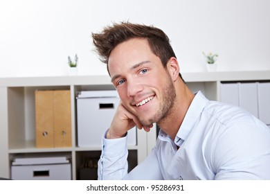 Portrait of attractive business man smiling in office