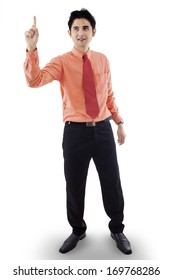 Portrait of attractive businessman getting an idea by pointing upwards