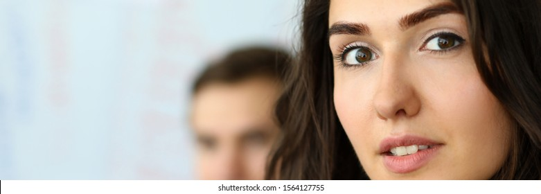 Portrait of attractive businesswoman looking at camera with gladness in modern conference room and discussing important contract. Biz meeting concept. Blurred background