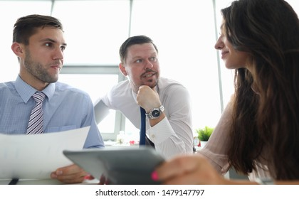Portrait of attractive businesswoman sitting with smiling colleagues. Classy businessman discussing signing profitable contract with partners. Biz meeting concept. Blurred background