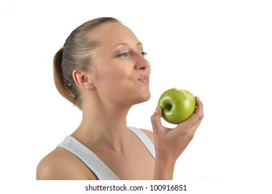 portrait of attractive caucasian smiling woman isolated on white studio shot eating green apple
