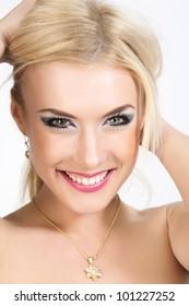Portrait of attractive caucasian smiling woman blond.