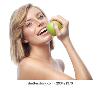 portrait of attractive  caucasian smiling woman blond isolated on white studio shot eating green apple