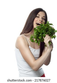 portrait of attractive  caucasian smiling woman isolated on white studio shot eating salat parsley