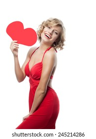 portrait of attractive  caucasian smiling woman isolated on white studio shot with heart in red dress