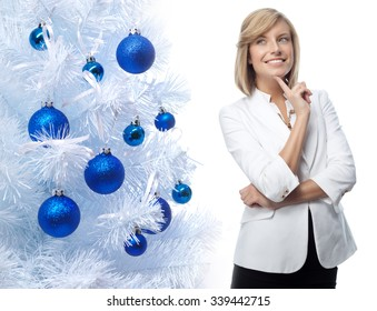 portrait of attractive  caucasian smiling woman isolated on white studio shot new year christmas tree blue balls