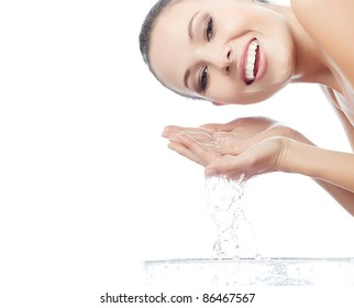 portrait of attractive  caucasian smiling woman isolated on white studio shot washing her face looking at camera