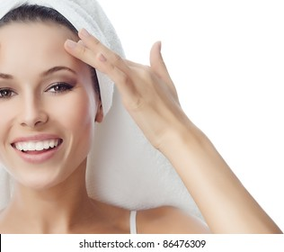 portrait of attractive  caucasian smiling woman isolated on white studio shot head in towel looking at camera