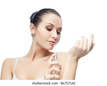 portrait of attractive  caucasian smiling woman isolated on white studio shot applying perfume