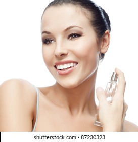 portrait of attractive  caucasian smiling woman isolated on white studio shot applying parfume