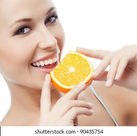 portrait of attractive  caucasian smiling woman isolated on white studio shot eating orange