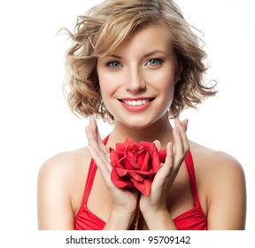 portrait of attractive  caucasian smiling woman blond isolated on white studio shot with red rose
