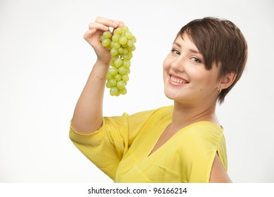 portrait of attractive caucasian smiling woman isolated on white studio shot with grapes