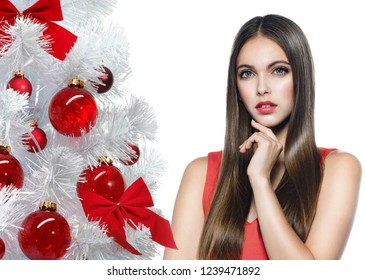 portrait of attractive caucasian smiling young woman brunette long hair isolated on white  studio shot red dress  face looking at camera hand christmas new year tree