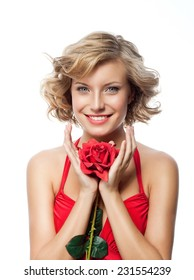 portrait of attractive  caucasian smiling young woman blond isolated on white studio shot with red rose flower