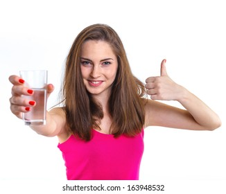 Portrait of attractive caucasian teenager girl drinking water at the glass. Isolated on white background.