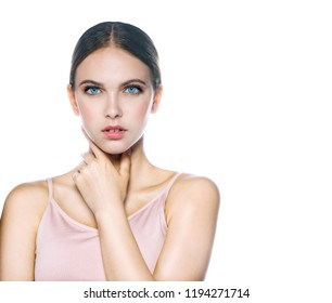 portrait of attractive caucasian woman brunette isolated on white studio shot lips  face head and shoulders looking at camera hand neck