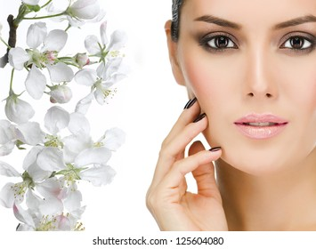 portrait of attractive  caucasian  woman brunette isolated on white studio shot face closeup skin eyes looking at camera flowers