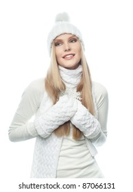 portrait of attractive  caucasian woman  with long blond hair in warm clothing isolated on white studio shot