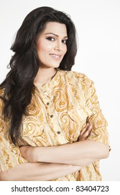 portrait of an attractive charming girl wearing paisley design shirt
