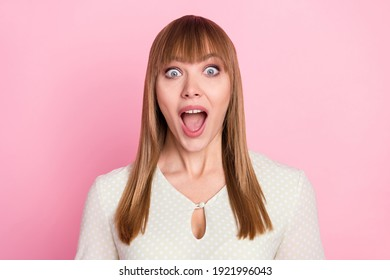 Portrait of attractive cheerful amazed blond girl great sudden news reaction isolated over pink pastel color background