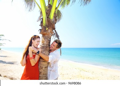 a portrait of attractive couple having date on the beach