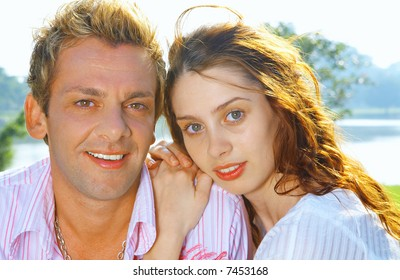a portrait of attractive couple in summer environment