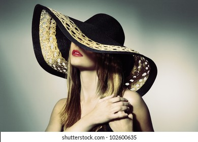 portrait of attractive elegant sexy woman with black hat - retro style