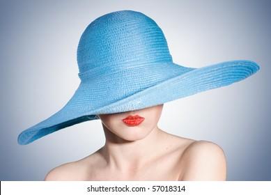 portrait of attractive elegant woman in blue hat