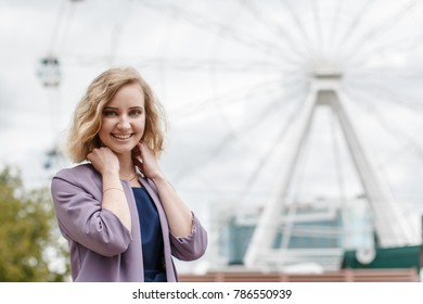 Portrait attractive girl with blond hair in the summer park