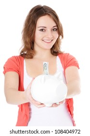 Portrait of an attractive girl holding piggy bank. All on white background.