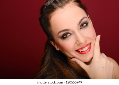 Portrait of attractive girl with red lips. Make up. Perfect teeth