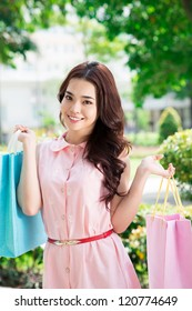 Portrait of an attractive girl with shopping bags