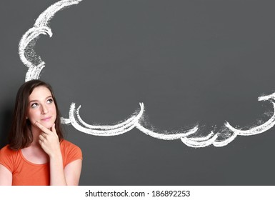 portrait of attractive girl thinking and looking up to blank bubble speech. ready for your design