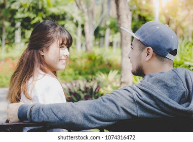 Portrait attractive handsome boyfriend and beautiful girlfriend: Charming beautiful woman is looking, admiring her boyfriend. They just in love together for while. They're talking about funny story
