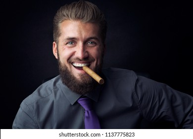 Portrait of an attractive happy business man with a cigar