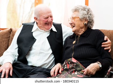 Portrait of an attractive happy senior couple posing close together