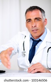 Portrait of a attractive latin doctor greeting at the medical consultation