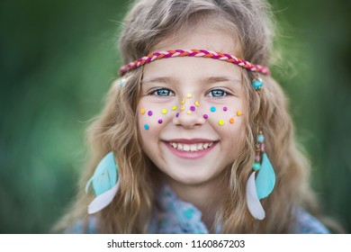 Portrait of an Attractive little girl in hippie style.